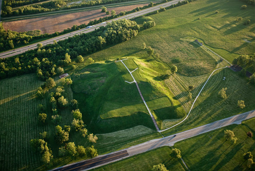 """Cahokia mounds, photographed by Ira Block for National Geographic; the mound immediately above is """"Monk's Mound"""", the largest (ten stories tall) of the Cahokia mounds.]"""